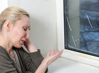 housewife cries,bad quality window has burst