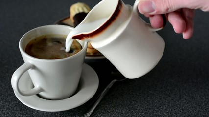 pouring milk into coffee - cookies