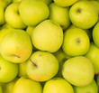Bunch of green apples in supermarket.