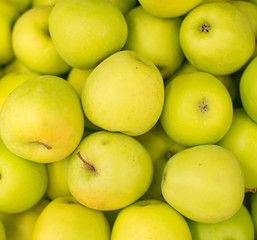 Bunch of green apples in supermarket.