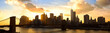 Manhattan panorama with Brooklyn Bridge at sunset, New York