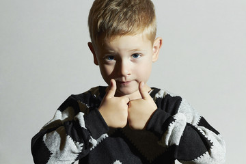 Funny child in sweater.fashion kids.children.little boy