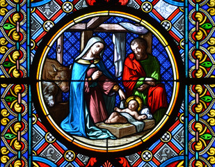 BASEL, SWITZERLAND - November 3, 2014: Nativity Scene. Stained g