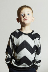 funny shock face child.sweater.children trend.little boy.emotion