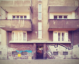 Vintage filtered picture of neglected tenement house. poster