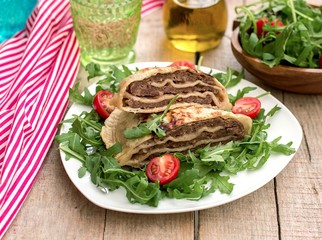 Layered meat pies with green salad