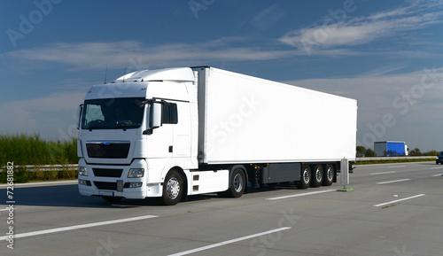 Leinwandbild Motiv LKW auf Autobahn // Truck on highway