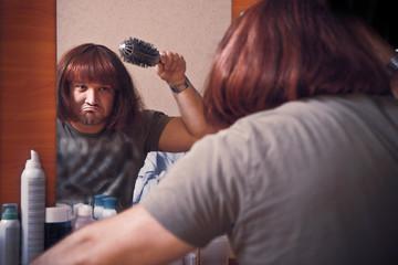 Man combs wig