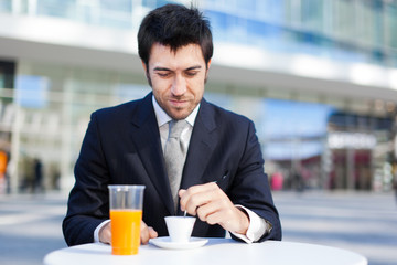Businessman having breakfast