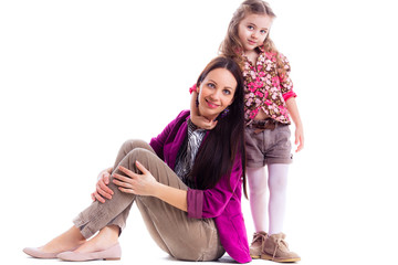 beautiful little girl her mother. Stylish clothing isolated