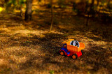 Toy truck and hardhat outdoors in the garden poster