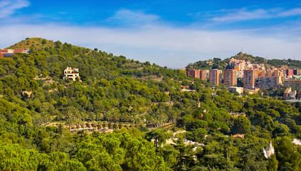 View of Barcelona and park Guel in sunny day