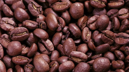 close up footage of rotating roasted coffee beans some zoom, som