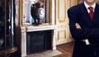 Leinwandbild Motiv Man standing inside luxury royal palace interior