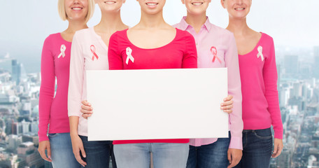 close up of women with cancer awareness ribbons