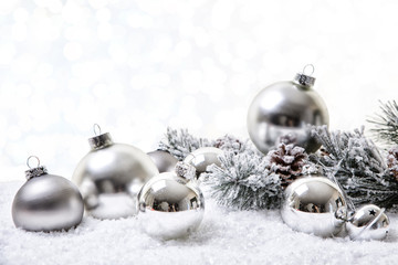 silver christmas bokeh background in snow