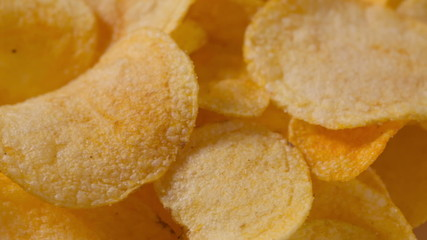 closeup potato chips rotating loopable footage, shot in RAW