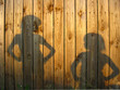 Shadow of boy and girl staring each other