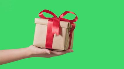 teen hand holding gift box, green screen