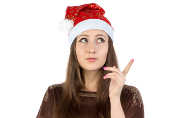 Photo of thinking young woman in xmas hat