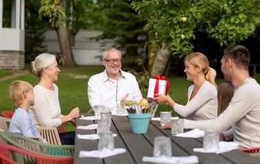 happy family having holiday dinner outdoors