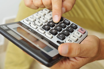 young man using a calculator