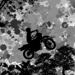 Jumping motorcycle rider