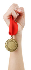 Golden medal in hand isolated on white