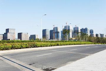 road of modern city and office building