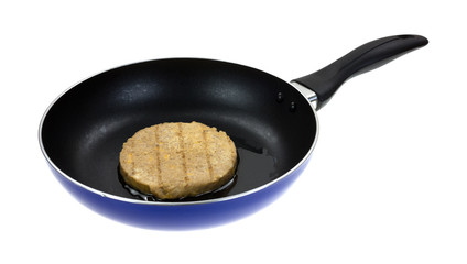 Veggie burger cooking in skillet