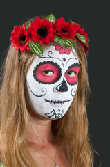 Girl with Calavera Mexicana makeup mask. Helloween