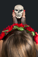 Girl with with scull in her hand. Halloween