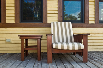 Chair on a wooden deck at a cottage