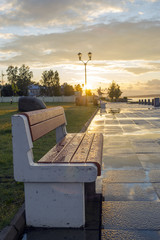 Bench in sunset cityscape