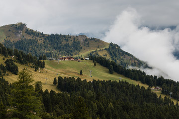 ski resort on forested slope in Dolomites