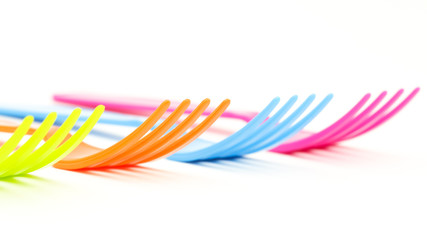 Close up colorful forks on white background