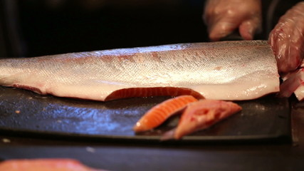 cleaning and slicing fish 2
