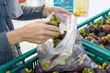 buying fruit at supermarket