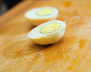 food preparation. cutting egg on blur backgrounds