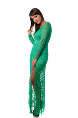 beautiful girl in green evening gown posing against white backgr