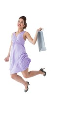 Happy brunette jumping with shopping bag