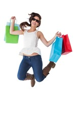 Happy brunette jumping with shopping bags