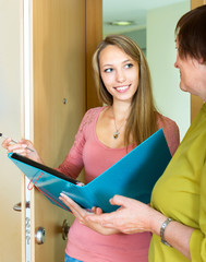 woman answer the questions of the social worker