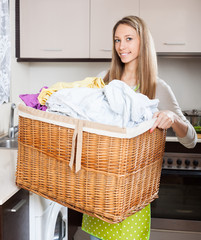 Happy woman with linen basket