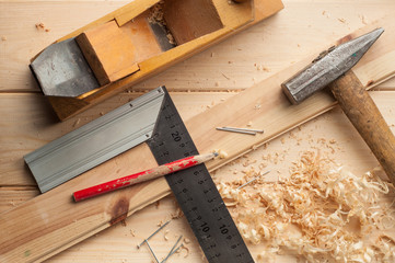 carpenter tools,hammer,meter, nails,shavings, and plane over