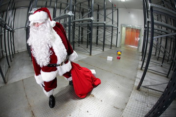 overworked Santa Claus loosing gifts from sack