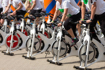 Stationary spinning bicycles outdoor in a sunny day. aerobic