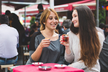 Two Women Drinking Cay, Traditional Turkish Tea, in Istanbul