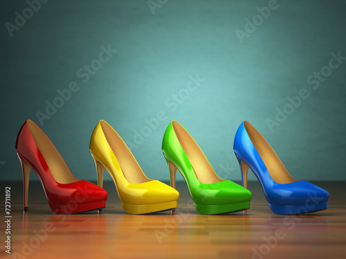 canvas print picture Choice of high heels shoes in different colors on vintage green