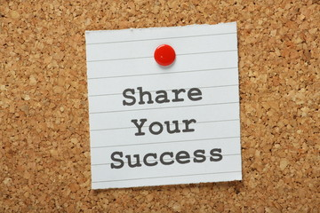 The phrase Share Your Success on a notice board
